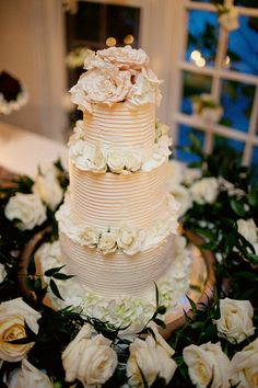 White soft butter frosting cake decorated with cream roses