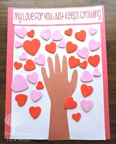 Try this fun and easy preschool Valentine's Day art project using construction paper and foam hearts. #valentinesday