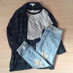 Grunge outfit idea nº21: Dark green and blue flannel shirt, short sleeve varsity T, and ripped light blue jeans