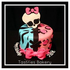 Girly skull cake with pink and teal fondant decor including zebra print, cheetah print and a bow! Tastries Bakery, Bakersfield Bakery.