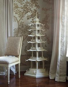 """A four-foot-high pagoda in the dining room of a Brookville, New York, house 'is just here to make people smile,' says designer Andrew Raquet. The silver tea-leaf wallpaper is from Gracie."" Interior design by Andrew Raquet. Gracie Wallpaper, Et Wallpaper, Chinoiserie Wallpaper, Silver Wallpaper, Chinoiserie Elegante, Style Asiatique, Oriental Decor, Asian Home Decor, Asian Design"
