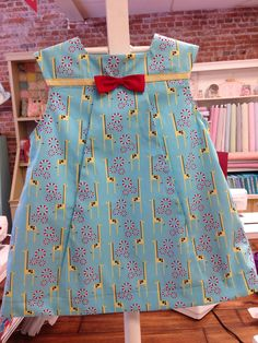 """Pattern used to sew this dress is """" Poppy"""" by The Children's Corner. Fabrics are…"""