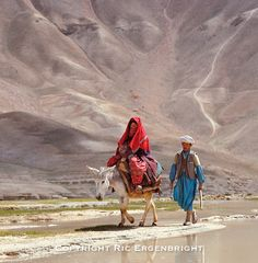 A couple travels along the road near Band-i-Amir in Afghanistan. ©Ric Ergenbright