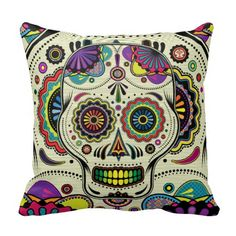 """Custom throw pillow with Day of the Dead / """"Dia de los Muertos"""" colorful design featuring a detailed illustration of sugar skull Aztec inspired art and ethnic motifs."""