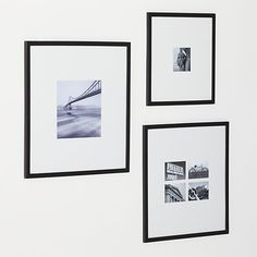 Classic black wood and extra-wide white mat frames in a modern, gallery-style presentation.