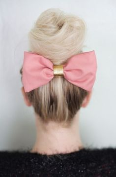 Loose top knot with pink and gold bow