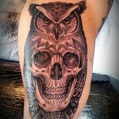 skull inside owl tattoo on sleeve