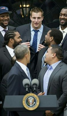 At the White House holding council with President Obama.