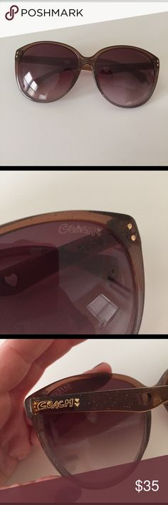 Coach sunglasses Previously loved Coach sunglasses. Brown color with subtle sparkles. Cute heart cutouts on sides. Screws need to be tightened, but I'm sure it's an easy fix. Comes with soft leopard carrying case 😎 (case is brand new). The a in coach on the right side has rubbed off slightly (as pictured). Coach Accessories Glasses