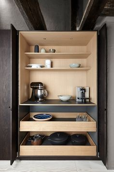 Hiding and sliding the doors away makes room for using the heavier equipment right where it belongs, inside the cupboards.