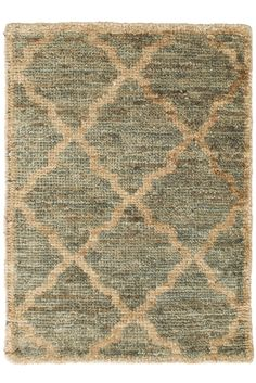 This hand knotted jute rug features a high profile, plush feel, and tile-inspired pattern with a beautifully timeworn look.