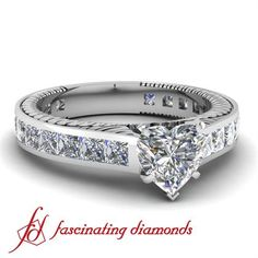 Classic Diamond Engagement Ring Flanked With Exquisite Channel Set Princess Cut Side Stones.