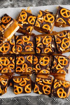 The perfect sweet and salty snack. These vegan chocolate caramel pretzel bars have a shortbread base topped with layers of gooey, stretchy caramel, dairy free chocolate and salted pretzels!