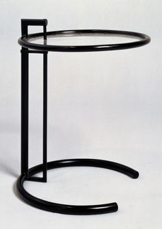 Eileen Gray - Adjustable Table 1926-1929. Note the open arc base to pull table up without interference of sofa or chair leg.