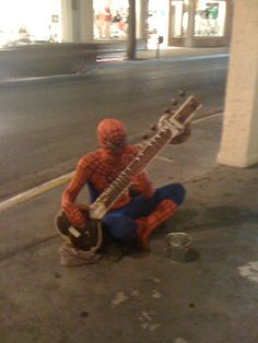 Spiderman. Playing the sitar.