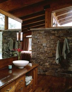 The master bath in this Montana home features a rough stone wall that continues from the interior to the outside of the home, while effectively separating the bathroom from the bedroom space. Rustic Bathroom Designs, Rustic Bathrooms, Modern Bathrooms, Interior Exterior, Home Interior Design, Barn Bathroom, Stone Bathroom, Master Bathroom, Montana Homes