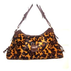"Stylish Leopard Print Hobo Bag Fabulous Leopard Print Hobo bag in Like New condition. Faux Textured Leather that looks like hair. All hardware in tact and in perfect working order. Zipper pocket in the back of bag. 3 separate compartments inside, plus zippered make up pocket AND wallet and cell phone side pockets!!  Striped lining inside has no tips or stains. Dimensions: 15 1/2""w x 5""d x 8""h. Bags Hobos"
