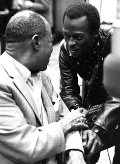 Miles Davis & Louis Armstrong - What an amazing photo of Miles paying homage to the Master.