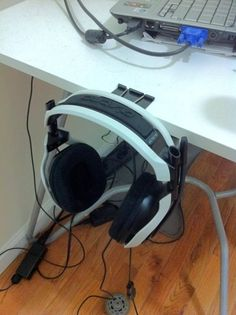 Use large binder clips to hold your (rather larger) headphones (...going to have to do this for the boyfriend I think!)