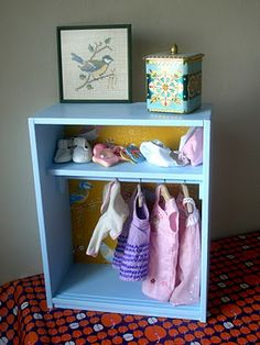 Doll clothes storage! Maybe in a crate?