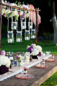 Maybe with a coconut leaf roof with Mason jar display. Table made with railway pallets. Table runner for decoration.