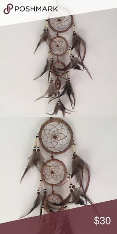"""Gorgeous goddess tiered dreamcatcher Handmade in bali featuring 4 cascading dreamcatcher rounds and natural fallen feather. Gorgeous tribal style beads for a unique look! Spans approximately 22"""". handmade Accessories"""