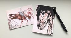 "Two note cards from my original drawings ""Steeplechase"" and ""Freckles""  * Two blank note cards 4.13 x 5.82 in (10.5 x 14.8 cm) * Printed on premium 250 g white card stock (Please note: the cards' background color on the front is cream)  * Includes white envelopes  * Packaged in protective, clear, resealable sleeves."