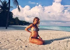 'Lots of love Rosie x':Rosie broke the news that she was pregnant with an Instagram post uploaded February 9 in which she sat smiling on a beach in a bikini, bump bare