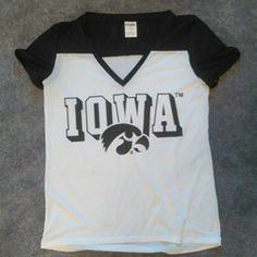 """NWOT VS Pink Jersey NWOT never worn Victoria's Secret Pink Iowa jersey shirt.  Bought to wear on """"college day"""" but didn't end up wearing it. Brand new condition, no holes, stains, or fading.  Size medium Make an offer! PINK Victoria's Secret Tops"""