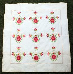 """Circa 1860-70 with both solid color and calico printed fabric, with very fine geometric, floral and feather hand quilting, 48 x 95""""."""