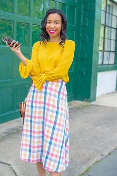 Washington DC blogger shares why you should wear clothing that makes you happy plus a tip for dealing with a changing body post-pandemic. // loopy cases, iPhone case, yellow blouse, gingham skirt, checkered skirt, plaid skirt spring, colorful outfits for women, Washington DC style blogger, Vera Bradley crossbody bag Casual Outfits For Moms, Mom Outfits, Stylish Outfits, Spring Outfits, Checkered Skirt, Gingham Skirt, Real Style, Mom Style, Colourful Outfits