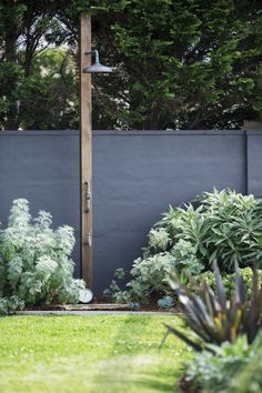 Coastal gardens, like this one with an outdoor shower, are designed to portray a beachy, relaxed vibe and look best when plants are left to grow in their natural shape, rather than a highly manicured finish. Photograhy: Jason Busch.