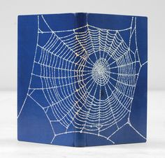 Charlotte's Web by E. B. White  Finely bound by The Chelsea Bindery in bright blue morocco, spider's web blocked in silver foil across the boards, twin rule to turn-ins in silver, cream endpapers, silver edges. Black and white illustrations in the text. A fine copy