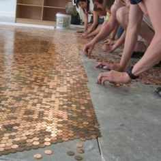 floor resurfacing DIY project with penny coins  A great way to use coins that you've saved but don't ever want to lose.