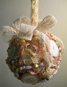 "Christmas ornament, handmade of vintage lace, pearls and buttons.  Measures approximately 2.5"" to 3"""