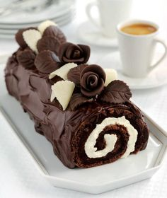 chocolate log cake with chocolate roses