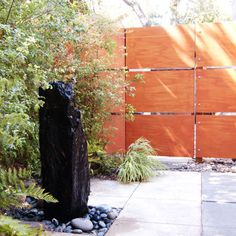 Great modern privacy fence out of plywood. Id love to do this!