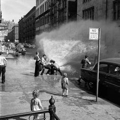Kids playing in a fire hydrant in NYC in the summer of 1954. | 18 Captivating Photos By The Mysterious Nanny-Photographer Of The Mid-Century