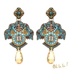 These gorgeous fan shaped citrine and swarovski crystal earrings look fantastic in blues and golds. The colors are very eye catching and the
