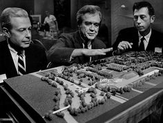 FEB 20 1969, FEB 21 1969, FEB 22 1969; Landscape Architect Garrett Eckbo, Center, Explains Model Of Botanic Gardens Master Plan.; Listening are John C. Mitchell II, left, board president, and Louis B. Martin, a board of trustees director.;