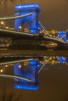 Budapest dressed the iconic Chain bridge in blue to celebrate World Children's Day. King B, Color Of Night, Reflection Photography, Magic City, Church Architecture, Budapest Hungary, Tower Bridge, Croatia, Paris