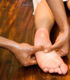 Pada-Abhyanga foot massage uses warm organic healing oil to massage the feet and the lower limbs