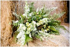 Rustic natural oversized bouquet, ferns and countryside flowers at woodland barn wedding in Lincolnshire by Lucabella.co.uk
