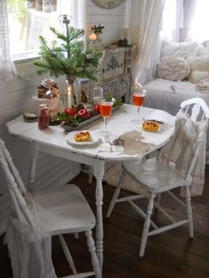 Shabby Chic Tiny Retreat...I love how cozy and pretty this is all dressed for the holidays. The all white scheme really opens up the space.