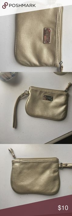 Gold Nine West Wristlet Barely used gold Nine West Wristlet. This is the perfect Wristlet for a night out when you need to keep up with a few things but don't want to haul your suitcase of a purse around. Nine West Bags Clutches & Wristlets