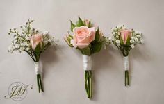 Pale pink spray roses and gypsophila buttonholes.