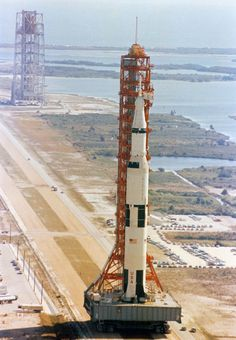 humanoidhistory:March 11, 1969 — The Apollo 10 rocket and launch tower, atop the ginormous crawler-transporter, inches its way to Launch Complex 39 at Kennedy Space Center. (NASA)