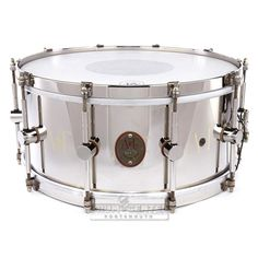 All Nickel Over Brass Snares are made from our patented raw brass shells, lugs, hoops, and hardware, with hand cut straight 45 degree edges and hand-filed snare beds.We cut, roll, weld and sand each drum. We found a nickel plater in Texas who's family has been plating nickel since 1930's. The grandson (46) now runs it, and worked with us to nickel plate our brass the way it was done on those old beautiful 1920s-1930s of old!The Nickel Over Brass Snares have a deep focused and crisp to...