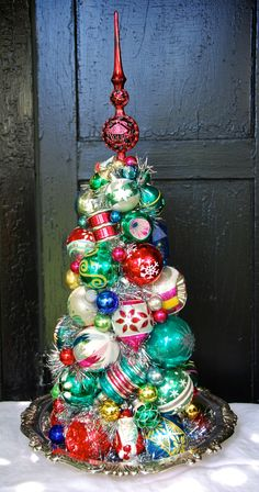 """HOLIDAY INN.  A lovely, multi-colored  topiary centerpiece on a vintage silverplate serving piece. 24 1/2"""" tall. $250"""