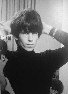 A rather young Keith Richards fixing his hair